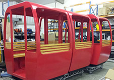 Sit-in cable car props for corporate event